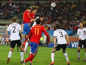 Puyol heading the ball